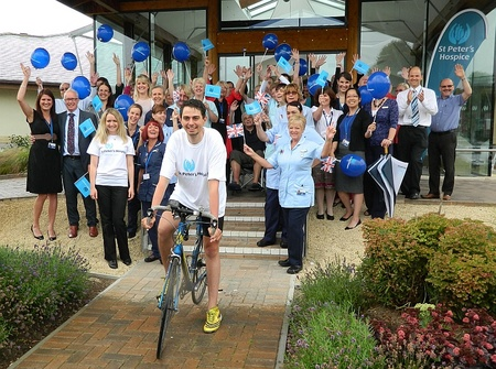 Marathon cyclist Mike Trevelyan arrives back at St Peter's Hospice.