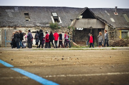 Church members look around the derelict site at the Old Barns.