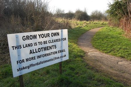 Sign announcing that land near Brins Close is to be cleared for allotments.
