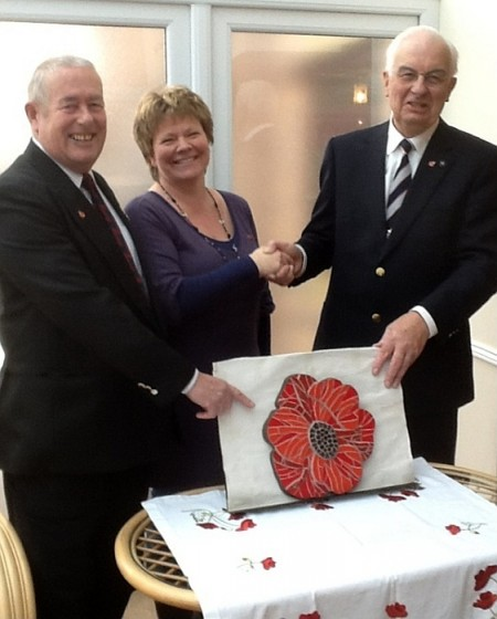 A poppy mosaic is presented to the Stoke Gifford branch of the RBL.