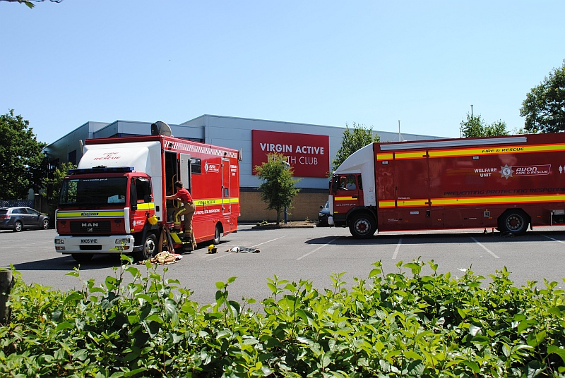 Fire service vehicles parked in the car park of the Virgin Active health club.