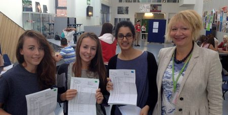 Students at Abbeywood Community School celebrate their GCSE results.