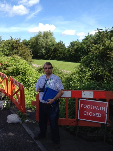Cllr Keith Cranney beside a landslip on Station Road, Little Stoke.