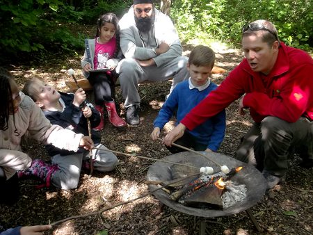 Pupils at Little Stoke Primary School toast marshmallows on a fire as part of their Forest Schools activities.