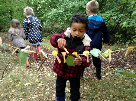 Collecting leaves at Little Stoke Primary's Forest School.