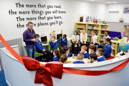 Performance poet Ian Bland recites a poem at the official opening of the new library area at Little Stoke Primary School.