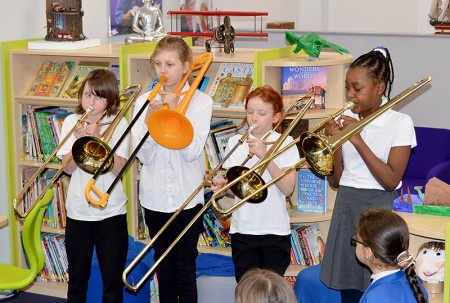 The Little Stoke Sliders play a fanfare at the official opening of the new library area at Little Stoke Primary School.