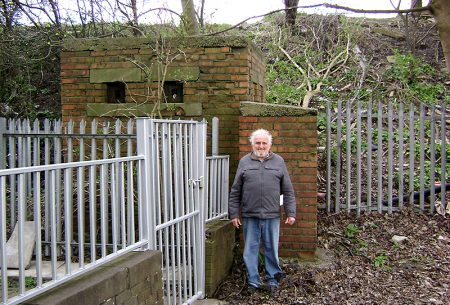 Brian Hawkins pictured beside the WWII pill box near Gipsy Patch Lane railway bridge that he is fighting to save.