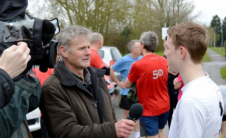 A BBC reporter interviews a runner in Little Stoke Park on the morning of the cancelled parkrun on 16th April 2016.