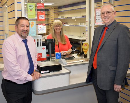 Jhoots directors and staff at the newly-refurbished post office in Ratcliffe Drive, Stoke Gifford. L-r: Richard Sugden (operations manager), Hazel Phelps (post office assistant) and Roger Herbert (director of primary care).