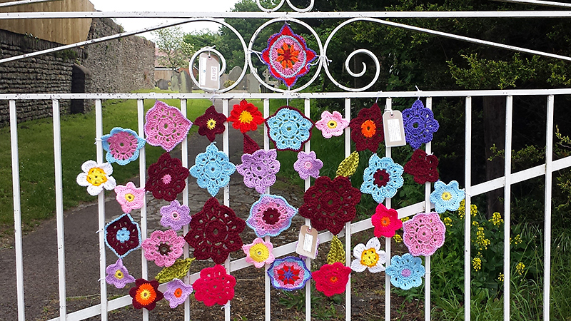 Yarn bombing on the gate leading to Parkway Station by St Mike's Yarn Bombers (SMYB).