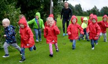 Jim Plunkett-Cole (a.k.a Jim Gump) running with children from Stoke Gifford Pre-School.