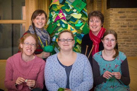 Members of the St Mike's Yarn Bombers (SMYB) with their Christmas tree (l-r): Debbie Bambridge, Emily Preston, Kia Harris, Sara Clothier and Zoe Garde-Evans.