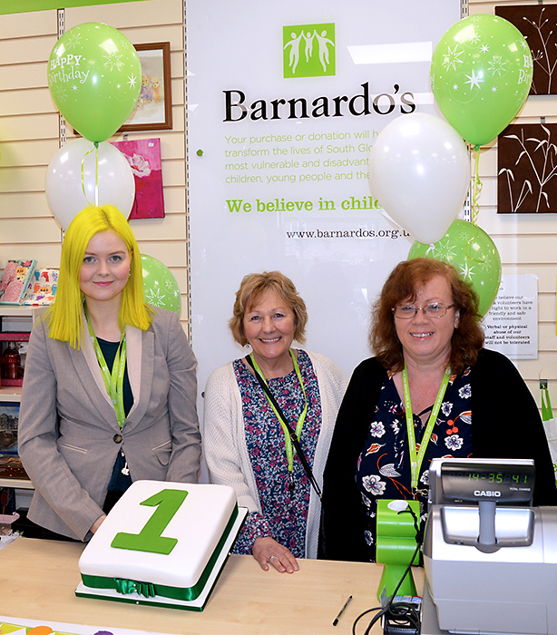 Photo of staff and volunteers at Barnardo's in Stoke Gifford, with a first anniversary cake.