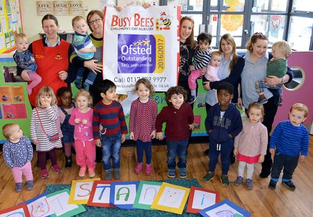 Photo of staff and children at Busy Bees Nursery in Stoke Gifford.