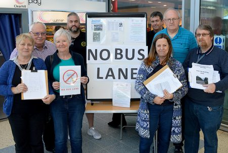 Photo of campaigners opposed to a new bus lane on Hatchet Road, Stoke Gifford, gathering petition signatures at the Willow Brook Centre.