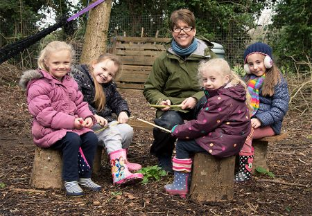 A group of children enjoy a Forest School session with Jenny Ratcliffe.