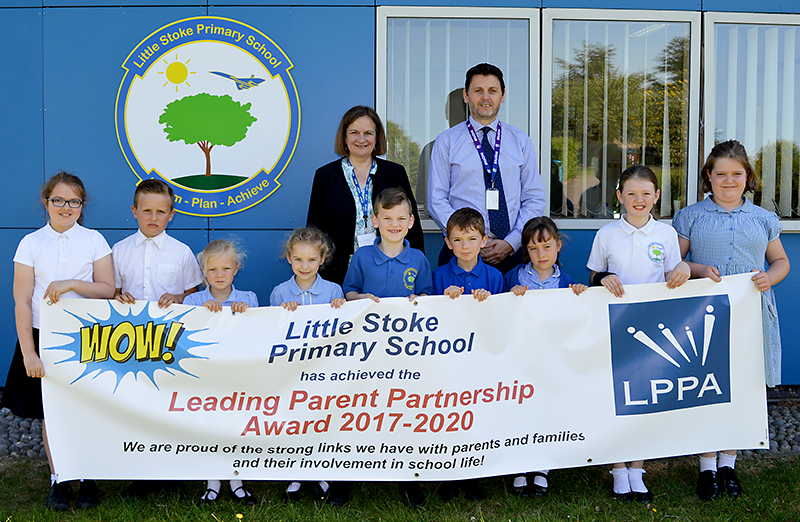 Photo of staff and pupils at Little Stoke Primary School standing behind a LPPA banner.