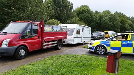 Travellers' vehicles leave Forty Acres, Stoke Gifford on Friday 18th August 2017.