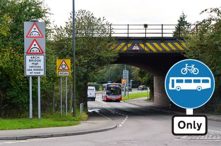 "Photo of the railway bridge near Parkway Station, with a ""buses and cycles only"" sign superimposed."