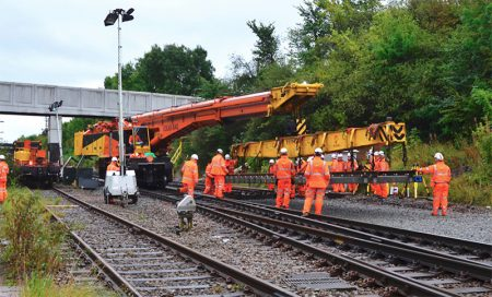 Photo of a 110-tonne Kirow crane laying track near Bristol Parkway.
