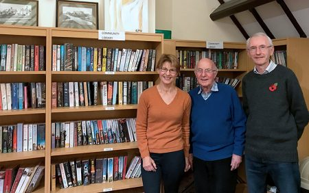 Photo of volunteers who run the community library.
