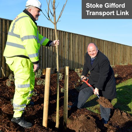 Photo of Cllr Matthew Riddle planting a tree.