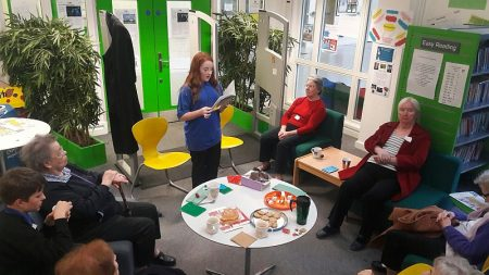 Year 9 student Liv Lewis, reading a selection of her own work to the residents of Osborne Court.