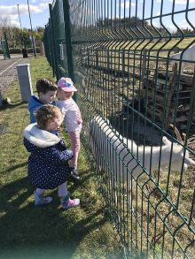 Children from the local community visiting the goats.