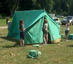 1st Little Stoke Scouts: Erecting tents at summer camp.