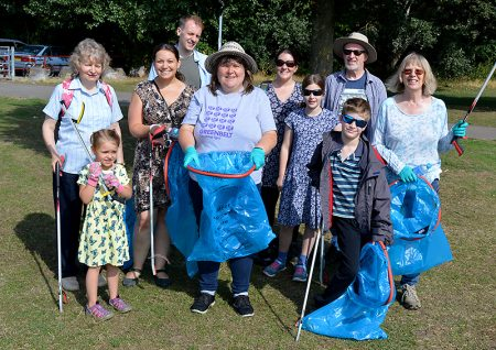 Photo of Jenny James (centre) with some of the local residents who took part in a recent litter pick in the park.