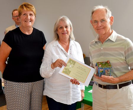 Photo of David Hutton receiving his award from Maureen Harris and Janice Szczelkun.