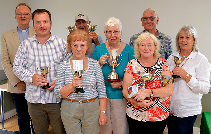 Photo of Rev Simon Jones (left) with some of the cup winners.