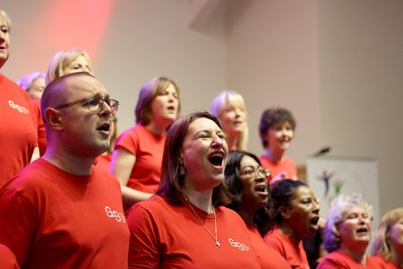 Photo showing some members of Stoke Gifford gospel choir singing during a performance.