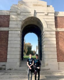 Photo of Tom and Anish outside Lijssenthoek cemetery.