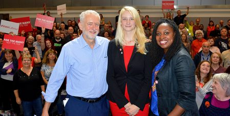 Photo of Jeremy Corbyn, Mhairi Threlfall and Dawn Butler on stage at the St Michael's Centre, with enthusiastic supporters in the background.