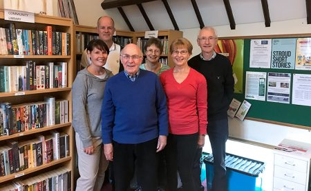 Photo of six volunteers at the community library.