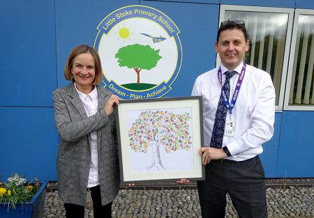 Photo of Anne Sargent presenting Scott Howes with the fingerprint tree.