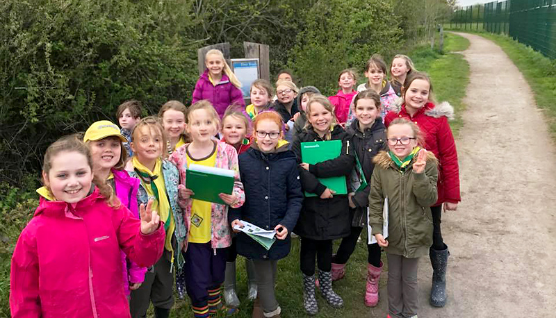 Photo of Brownies taking part in the nature orienteering trail at Three Brooks Nature Reserve, Bradley Stoke.