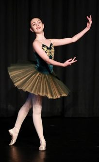 Photo of Grace Cousins dancing.