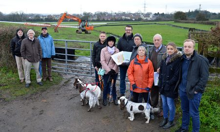 Photo of concerned residents gathered at a field gate near the junction of Westfield Lane and Harry Stoke Road.