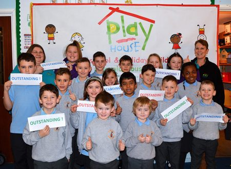 Photo of staff and children at Play House Afterschool & Holiday Club celebrating their recent 'outstanding' Ofsted grading.