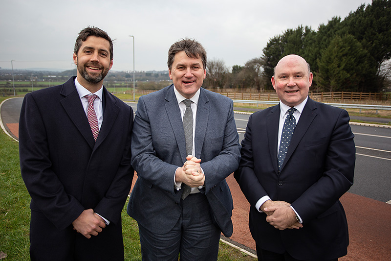 Photo of Cllr Toby Savage, Kit Malthouse and Tim Bowles standing beside the new Stoke Gifford By-Pass.