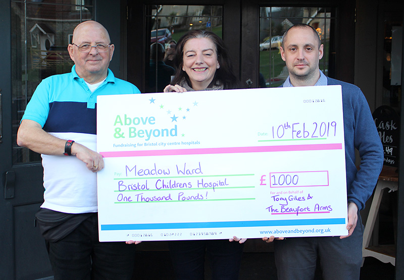 Photo of the charity cheque presentation in front of the Beaufort Arms.