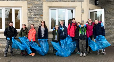 Photo of Scouts gathered outside The Old Schools Rooms prior to the start of their litter-picking walk.