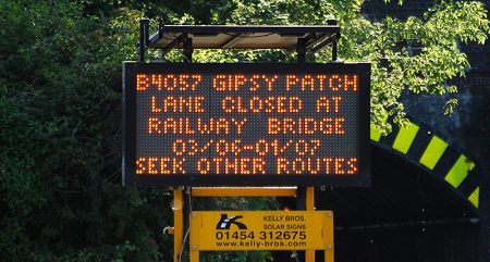 Photo of a matrix sign displaying a message about the planned closure of Gipsy Patch Lane for four weeks in June 2019.