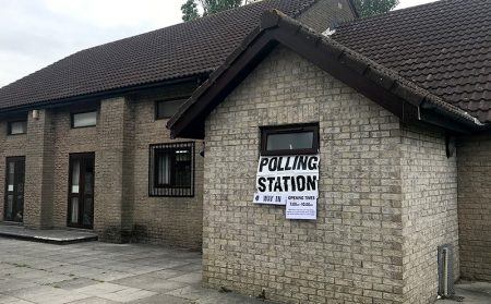 Photo of the outside of a polling station at the Trust Hall.
