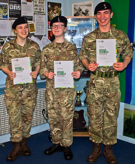 Photo of Sgt Gurr, L/Cpl Reynolds and Cdt Bishop receiving their Youth First Aid certificates.