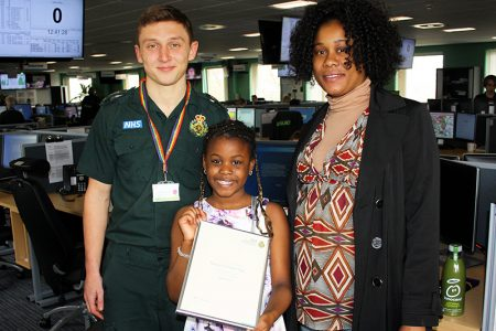 Photo of Jonathan Leaton (emergency medical dispatcher) with Massa Sow and Catherine Camara.