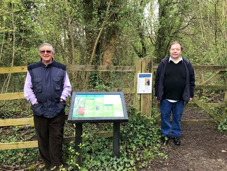 Photo of conservation group members Fred Hillberg (left) and David Bell at the entrance to the wood.